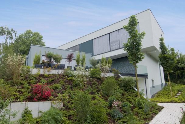 Einfamilienhaus im stil der klassischen moderne holle for Einfamilienhaus klassisch